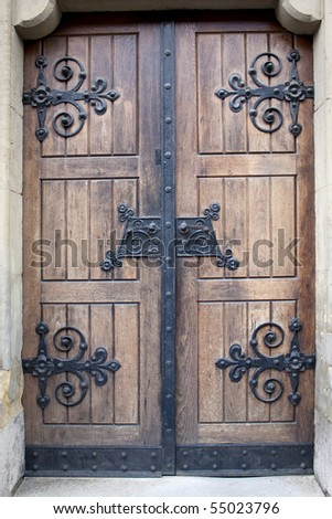 Wooden church sideways door with iron pattern.