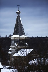 Wooden churches and houses in the village in winter