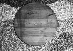 wooden circle on rock background,black and white