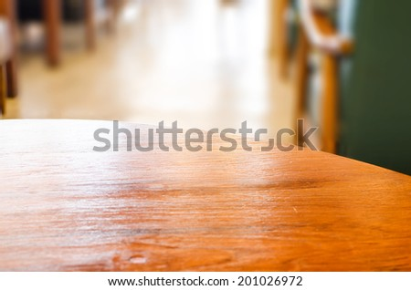 wooden circle table top and blur cafe background