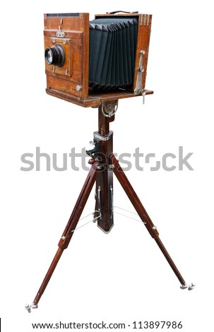Wooden classic retro camera on tripod. Clipping path included.