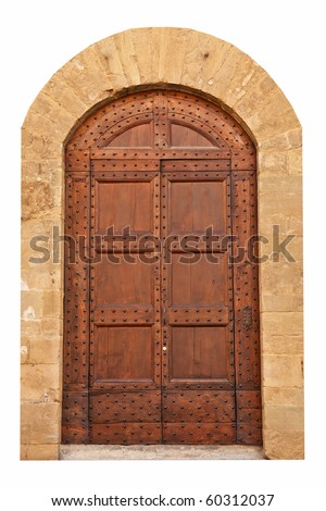 Wooden closed brown door with ornaments and two door handle, Italy.