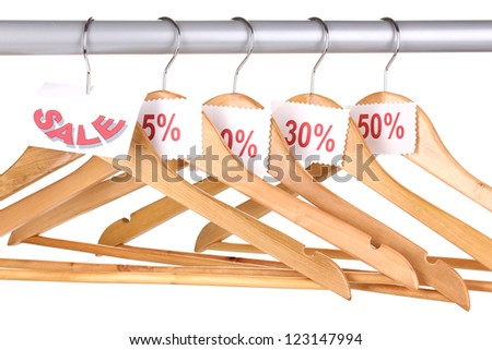 wooden clothes hangers as sale symbol isolated on white