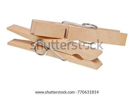 Wooden clothes pegs isolated on a white background