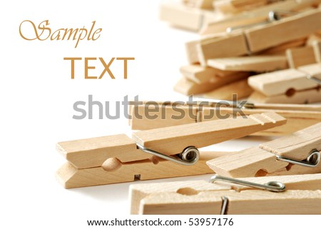 Wooden clothespins on white background with copy space.  Macro with shallow dof.
