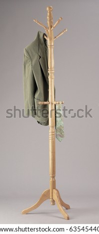 Wooden coat rack or hall stand, isolated on grey background.