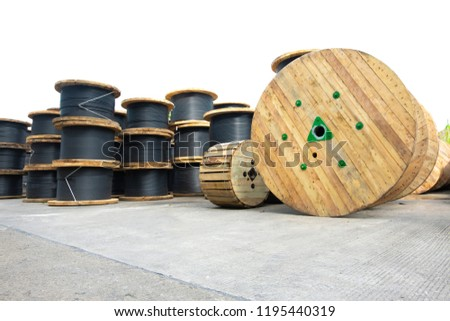 Wooden Coils Of Electric Cable Outdoor. High and low voltage cables in the storage. #1195440319