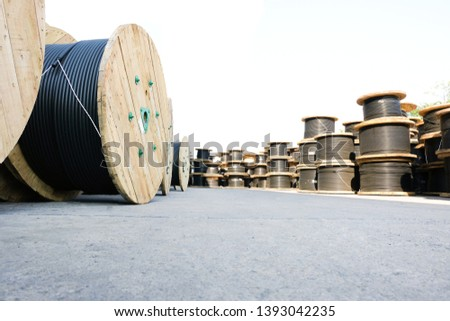Wooden Coils Of Electric Cable Outdoor. High and low voltage cables in the storage. #1393042235
