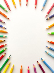 Wooden, color pencils on white paper background with oval shape. Perfect for conexpt, idea text.