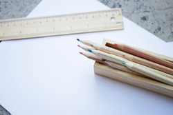 Wooden Colored pencils and ruler on white paper in nature concept