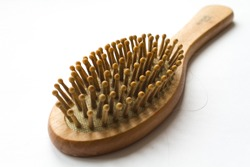 wooden comb with hair. hair loss problem.