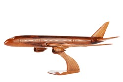 Wooden commercial airplane model on a white background