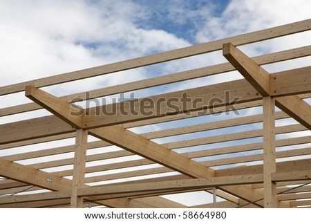 Wooden construction made of beams and planks - stock photo