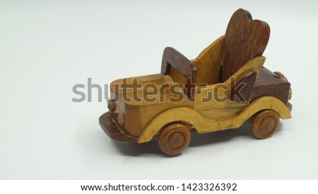Wooden convertible car on bright background. Wooden convertible car toy for home decoration.                                #1423326392