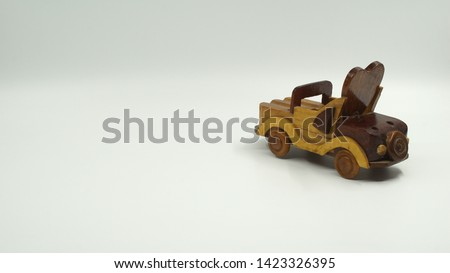 Wooden convertible car on bright background. Wooden convertible car toy for home decoration.                                #1423326395
