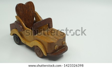 Wooden convertible car on bright background. Wooden convertible car toy for home decoration.                                #1423326398