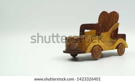 Wooden convertible car on bright background. Wooden convertible car toy for home decoration.                                #1423326401