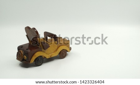 Wooden convertible car on bright background. Wooden convertible car toy for home decoration.                                #1423326404