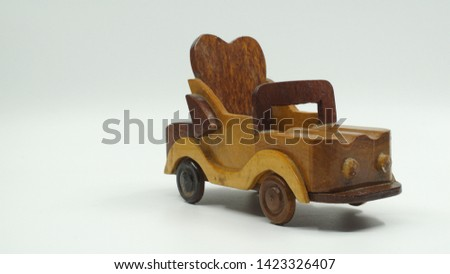 Wooden convertible car on bright background. Wooden convertible car toy for home decoration.                                #1423326407