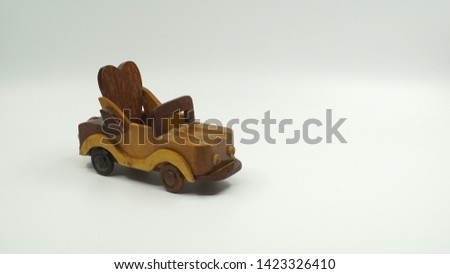 Wooden convertible car on bright background. Wooden convertible car toy for home decoration.                                #1423326410
