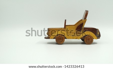 Wooden convertible car on bright background. Wooden convertible car toy for home decoration.                                #1423326413