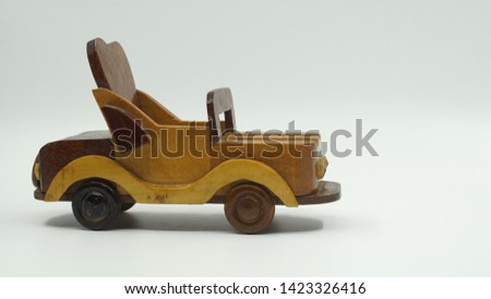 Wooden convertible car on bright background. Wooden convertible car toy for home decoration.                                #1423326416