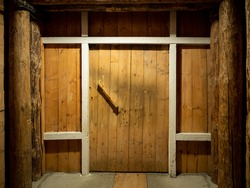Wooden corridor with door in the salt mining caves.