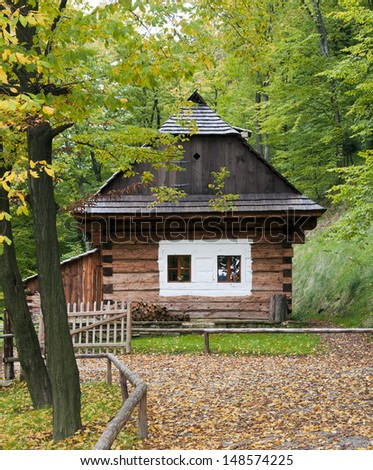 Wooden cottage house in autumn forest countryside, Roznov pod Radhostem, Czech Republic.