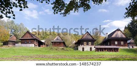 Wooden cottage houses in autumn rural countryside, Roznov pod Radhostem, Czech Republic.