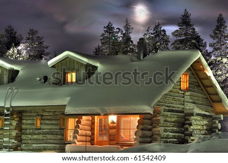 Wooden cottage in the winter's evening. Finland.