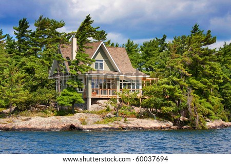 wooden cottage on the lake