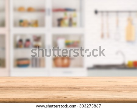 wooden counter top with kitchen cabinet background