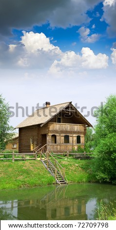Wooden country house on the lake in summer