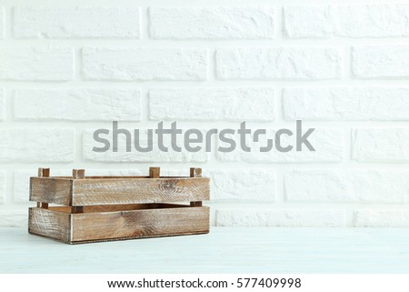 Wooden crate on the brick wall background #577409998