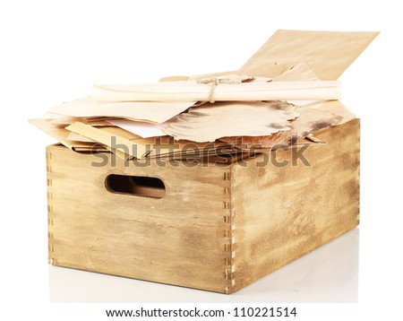 Wooden crate with papers and letters isolated on white