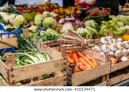 Shutterstock Wooden crates of carrots, garlic and other fruit and veg at Campo de Fiori, Rome