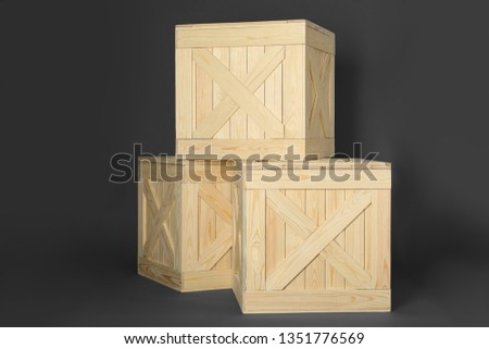 Wooden crates on dark background. Shipping containers #1351776569