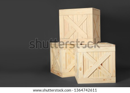 Wooden crates on dark background, space for text. Shipping containers #1364742611