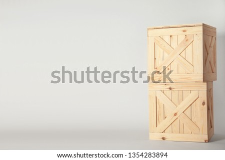 Wooden crates on light background, space for text. Shipping containers #1354283894