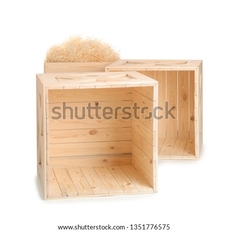 Wooden crates on white background. Shipping containers #1351776575