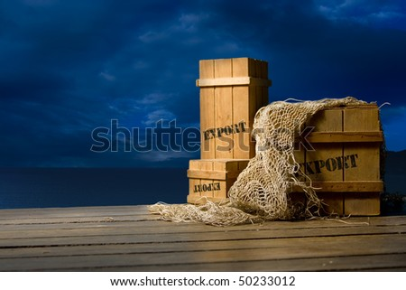 Wooden crates packed for export on a dock