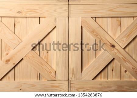 Wooden crates with crossed planks as background, closeup #1354283876