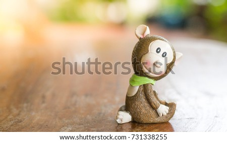 wooden craved monkey smiling on ...