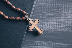wooden cross on the book
