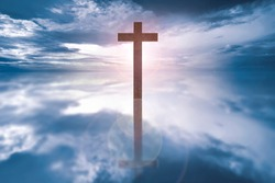 Wooden cross on the river with sunlight background