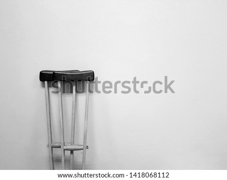Wooden crutches Walking aids that used when you have injury about orthopedic. With black and white background #1418068112