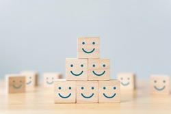 Wooden cube block shape with icon face smiley, The best excellent business services rating customer experience, Satisfaction survey concept