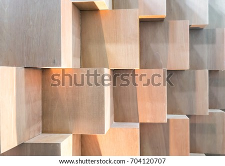 Wooden cube boxes creating abstract geometric wall background #704120707