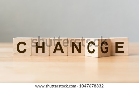 "Wooden cube flip with word ""change"" to ""chance"" on wood table, Personal development and career growth or change yourself concept #1047678832"