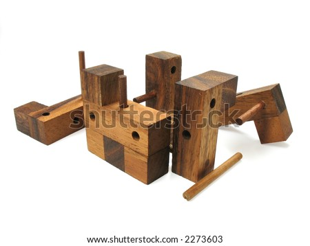 Wooden cube puzzle. Isolated on white background. Contains Clipping Path.